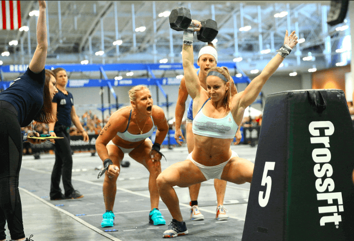 Crossfit trainer yelling at woman lifting